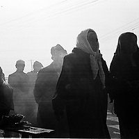 KASGHAR :30 SEPTEMBER 2001: 2 old Uighur women walk on the bazaar in Kashgar..Uighur muslims in southern Xinjiang province lead very basic lifestyles and have an average monthly income of about 50 US$.. . .  . .