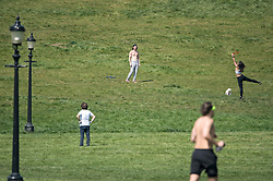 **CAPTION CORRECTION**<br /> © Licensed to London News Pictures. 11/04/2020. London, UK. People playing frisbee on Primrose Hill, London over Easter Bank holiday weekend, during a pandemic outbreak of the Coronavirus COVID-19 disease. The public have been told they can only leave their homes when absolutely essential, in an attempt to fight the spread of coronavirus COVID-19 disease. Photo credit: Ben Cawthra/LNP