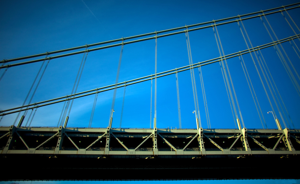 The Verrazano-Narrows Bridge is a double-decked suspension bridge that connects the boroughs of Staten Island and Brooklyn on Long Island in New York City at the Narrows, the reach connecting the relatively protected upper bay with the larger lower bay.<br /> The bridge is named for Italian explorer Giovanni da Verrazzano, the first known European navigator to enter New York Harbor and the Hudson River, while crossing The Narrows. It has a center span of 4,260 feet (1,298 m) and was the largest suspension bridge in the world at the time of its completion in 1964, until it was surpassed by the Humber Bridge in the United Kingdom in 1981. It now has the eighth longest center span in the world, and is the largest suspension bridge in the United States. Its massive towers can be seen throughout a good part of the New York metropolitan area, including from spots in all five boroughs of New York City.<br /> The bridge furnishes a critical link in the local and regional highway system. It is the starting point of the New York City Marathon. The bridge marks the gateway to New York Harbor; all cruise ships and most container ships arriving at the Port of New York and New Jersey must pass underneath the bridge and thus must be built to accommodate the clearance under the bridge.