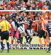 Dundee's James McPake, Thomas Konrad and Paul McGinn combine to clear a corner - Dundee United v Dundee at Tannadice Park in the SPFL Premiership<br /> <br />  - &copy; David Young - www.davidyoungphoto.co.uk - email: davidyoungphoto@gmail.com