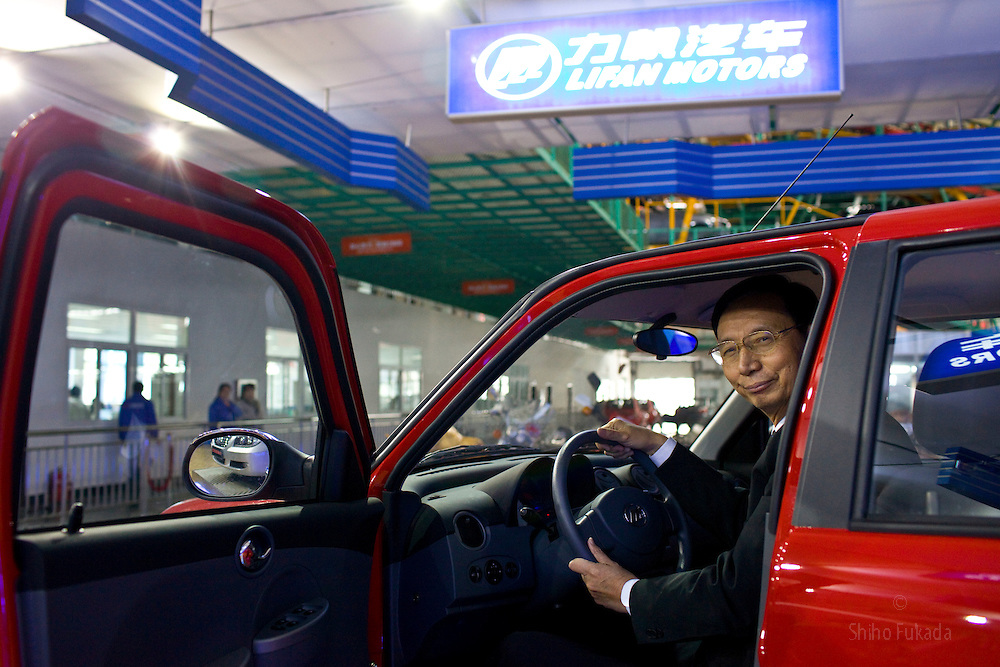 "Yin Ming Shan, the ""motorcycle king"", President of Lifan Industry, poses for a portrait at his car factory in Chongqing, China, March 4, 2009."