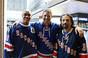 May 8, 2015 - New York, NY. Rangers fans prepares to walk into Madison Square Garden for game 5 of the Rangers-Capitals series.  Photograph by Anthony Kane/NYCity Photo Wire
