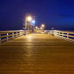 San Clemente pier at night picture. San Clemente is a popular coastal beach city in Orange County California in the United States of America. Copyright ⓒ 2017 Paul Velgos with All Rights Reserved.