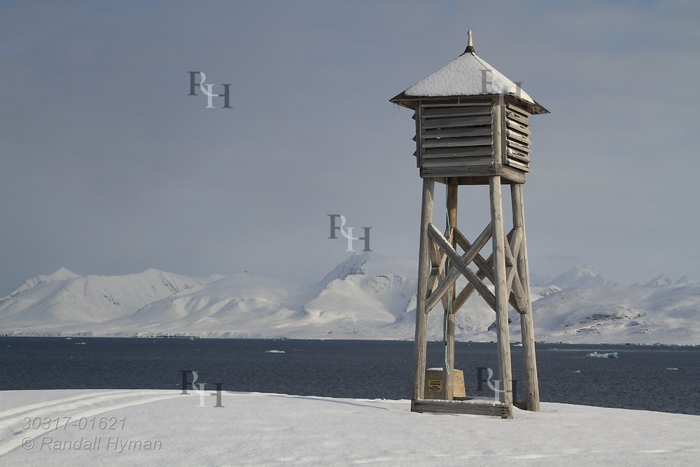 Weather station box overlooks fjord called Kongfjorden at the international science village of Ny-Alesund on Spitsbergen island; Svalbard, Norway.