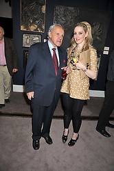 PANAGIOTIS LEMOS and      at a party to celebrate the publication of Elena Makri Liberis's book 'Every Month, Same day' held at Sotheby's, 34-35 New Bond Street, London on 5th May 2009.