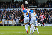 Exeter City's Jayden Stockley is out numbered as he jumps for a header during the Sky Bet League 2 match between Bristol Rovers and Exeter City at the Memorial Stadium, Bristol, England on 23 April 2016. Photo by Shane Healey.