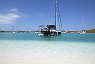 Sailboats at anchor in the crystal clear water of Elizabeth Harbor near George Town, Great Exuma in the Bahamas.  Hundreds of cruisers come to this place each year as a waypoint before sailing south - or, for most, to spend the entire winter near this small Bahamian town.