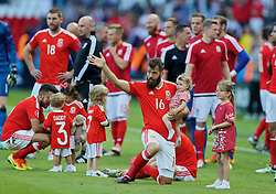 PARIS, FRANCE - Saturday, June 25, 2016: Wales' Joe Ledley and his daughter after the 1-0 victory over Northern Ireland during the Round of 16 UEFA Euro 2016 Championship match at the Parc des Princes. (Pic by David Rawcliffe/Propaganda)