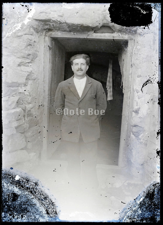 eroding glass plate photo of adult man in door opening