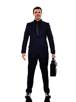 one caucasian business man standing smiling in silhouette on white background