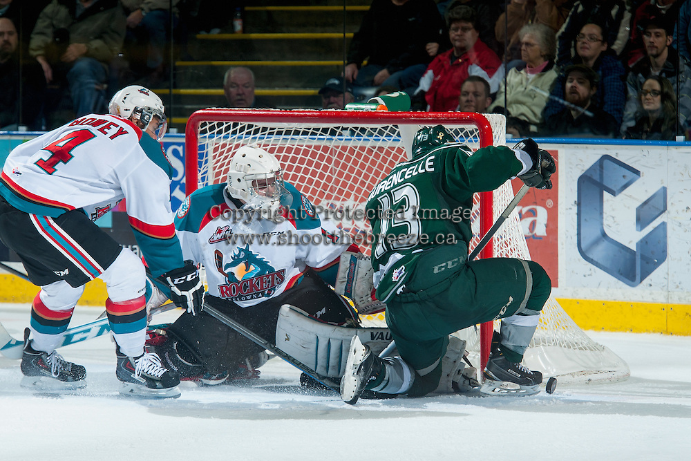 KELOWNA, CANADA - JANUARY 23: Jackson Whistle #1 of Kelowna Rockets makes a save from a shot by Remi Laurencelle #13 of Everett Silvertips on January 23, 2015 at Prospera Place in Kelowna, British Columbia, Canada.  (Photo by Marissa Baecker/Shoot the Breeze)  *** Local Caption *** Jackson Whistle; Remi Laurencelle;