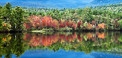 Fall color -- sugar maples -- blazing on the shores of an unnamed lake, off Highway 113, south of Conway.