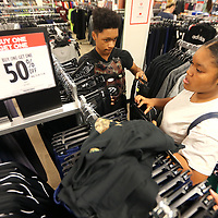Daylon Barnes, 13, of Ripley, and his twin sister Kaylin, shop for clothes at JCPenney during the tax free weekend for their back to school needs Friday morning at The Mall at Barnes Crossing in Tupelo.