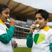 Children from All Souls Prinary SChool enjoy the green Show the Love hearts cakes at Lord's. Schoolchildren from All Souls Primary School in London join MP James Heappey and Marylebone Cricket Club (MCC) Chief Executive Derek Brewer at Lord's to launch The Climate Coalition's #ShowtheLove campaign. The annual celebration of all that we love but could lose to climate change, from cricket pitches to woodlands, and the progress we are making towards a clean and secure future. The campaign encourages people to wear and share green hearts to demonstrate their support this Valentine's Day.