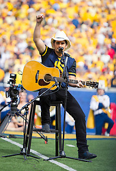 "Sep 26, 2015; Morgantown, WV, USA; Country music singer Brad Paisley performs ""Country Roads"" prior to kickoff at Milan Puskar Stadium. Mandatory Credit: Ben Queen-USA TODAY Sports"