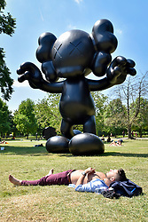 "© Licensed to London News Pictures. 05/07/2017. London, UK. ""Final Days"", 2013, by KAWS.  The Frieze Sculpture festival opens to the public in Regent's Park.  Featuring outdoor works by leading artists from around the world the sculptures are on display from 5 July to 8 October 2017.  Photo credit : Stephen Chung/LNP"