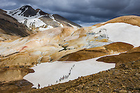 Hikers in Kerlingarfjöll Mountains geothermal area, Highlands of Iceland. Steam from geothermal vents and mudpools.