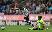 Bolton Wanderers striker Alves Wellington Silva fouled by Brighton defender, Uwe Huenemeier during the Sky Bet Championship match between Bolton Wanderers and Brighton and Hove Albion at the Macron Stadium, Bolton, England on 26 September 2015.