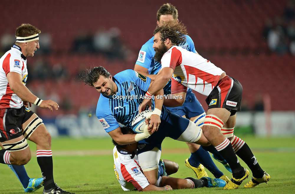 JOHANNESBURG, South Africa, 14 April 2012. Jacques Potgieter of the Bulls is tackled by Elton Jantjies and Joshua Strauss (Capt) of the Lions during the Super15 Rugby match between the Lions and the Bulls at Coca-Cola Park in Johannesburg, South Africa on 14 April 2012. The Bulls won this away game 32-18.<br /> Photographer : Anton de Villiers / SASPA