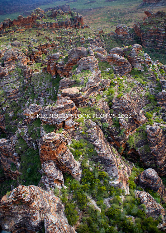 The dramatic orange domes of the Bungle Bungles wear a green fringe in the Kimberley wet season.