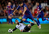 VALENCIA, SPAIN - FEBRUARY 08:  Luis Suarez of Barcelona is tackled by Montoya of Valencia during the Copa del Rey semi-final second leg match between Valencia and Barcelona at Mestalla Stadium on February 8, 2018 in Valencia, Spain.  (Photo by Manuel Queimadelos Alonso/Getty Images)