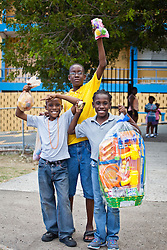 (L-R) Chris, O'daunte, and Chrisnnae Rommis.  Impacting Your World Christian Ministries helicopter egg drop at Charlotte Amalie High School.  St. Thomas, USVI.  4 April 2015.  © Aisha-Zakiya Boyd