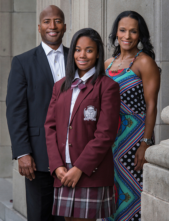 Michael Harris, left, poses for a photograph with his wife Tammy Harris, right, and daughter Hannah Harris, center at Young Women's College Preparatory Academy, September 30, 2014.