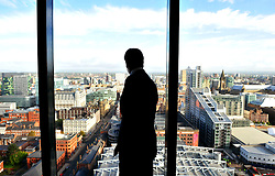 Leader of the Conservative Party David Cameron looks out  the  window of  the 23rd floor at the Hilton Hotel in Manchester  after going on the Andrew Marr  show on the eve of the Conservative Party Conference, Sunday October 4, 2009. Photo By Andrew Parsons / i-Images.