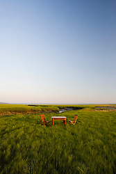 Wooden table and chairs in a salt marsh Massachusetts USA