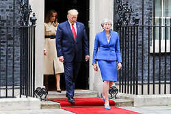 © Licensed to London News Pictures. 04/06/2019. London, UK. President of the United States Donald Trump and British Prime Minister Theresa May along with First Lady Melania Trump and Philip May leave 10 Downing Street for the Foreign and Commonwealth Office for a joint press conference on the second day of the State Visit. Photo credit: Dinendra Haria/LNP
