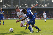 AFC Wimbledon striker Andy Barcham (17)and Northampton Town defender Aaron Phillips (18) during the EFL Sky Bet League 1 match between AFC Wimbledon and Northampton Town at the Cherry Red Records Stadium, Kingston, England on 11 March 2017. Photo by Stuart Butcher.