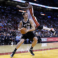 17 January 2012: Miami Heat power forward Udonis Haslem (40) jumps over San Antonio Spurs forward Tiago Splitter (22) during the Miami Heat 120-98 victory over the San Antonio Spurs at the AmericanAirlines Arena, Miami, Florida, USA.