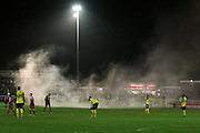 A flare on the pitch during the The FA Cup 2nd round replay match between Whitehawk FC and Dagenham and Redbridge at The Enclosed Ground, Whitehawk, Brighton, United Kingdom on 16 December 2015. Photo by Ellie Hoad.
