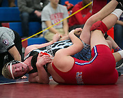 Jacob Fujimura of Fairport competes against Tom Mueller of Midlakes in the 182-pound weight class during a match at Fairport High School on Saturday, December 13, 2014.