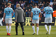 Manchester City midfielder Kevin De Bruyne (17), Manchester City Manager Pep Guardiola, Manchester City forward Gabriel Jesus (33) and Manchester City defender Benjamin Mendy (22) walk off the pitch after the Premier League match between Crystal Palace and Manchester City at Selhurst Park, London, England on 14 April 2019.