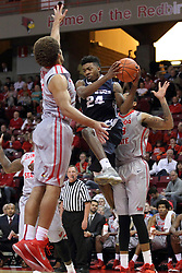 16 November 2014:  Jojo McGlaston flies towards the hoop wedged between Reggie Lynch and Deontae Hawkins during an NCAA non-conference game between the Utah State Aggies and the Illinois State Redbirds.  The Aggies win the competition 60-55 at Redbird Arena in Normal Illinois.