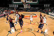 February 20, 2014: Shakeya Leary #34 of Syracuse blocks the shot from Suriya McGuire #33 of Miami during the NCAA basketball game between the Miami Hurricanes and the Syracuse Orange at the Bank United Center in Coral Gables, FL. The Orange defeated the Hurricanes 69-48.