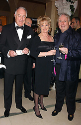 Left to right, JOHN BOWES-LYONS, DAWN PERRETT and CHRISTOPHER BIGGINS at A Riot - 1930's evening in aid of Great Ormand Street Hospital held at Claridge's, Brook Street, London on 31st January 2006.<br />