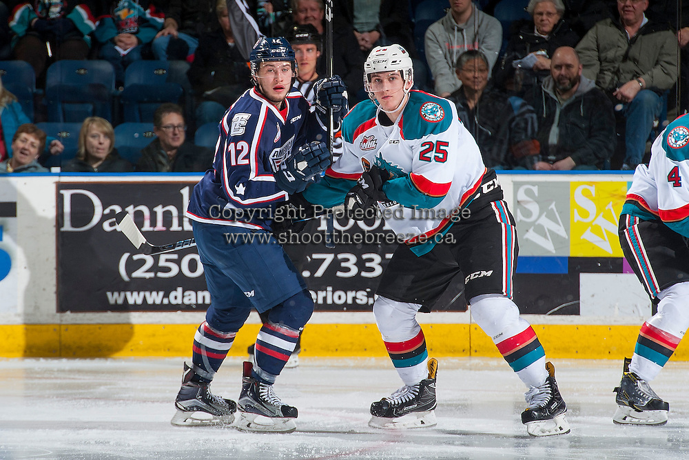 KELOWNA, CANADA - MARCH 4: Jordan Topping #12 of the Tri-City Americans is checked by Cal Foote #25 of the Kelowna Rockets on March 4, 2017 at Prospera Place in Kelowna, British Columbia, Canada.  (Photo by Marissa Baecker/Shoot the Breeze)  *** Local Caption ***