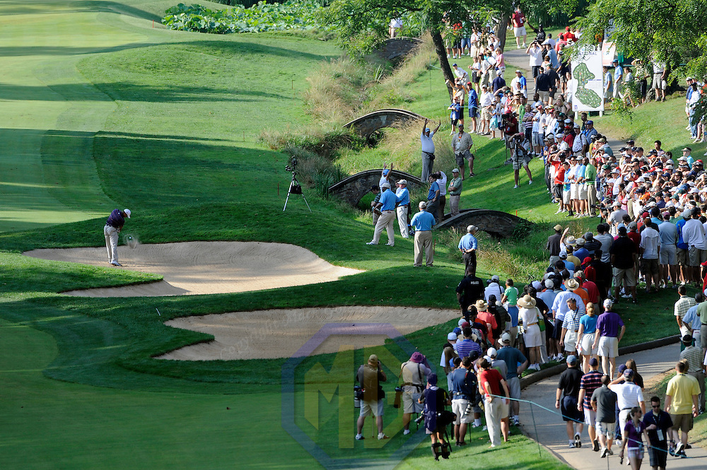 03 July 2009:  Tiger Woods hits out of a bunker on the 11th hole in the second round of the  AT&T National PGA event hosted by Tiger Woods at Congressional Country Club in Potomac, Md.   ****For Editorial Use Only****
