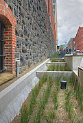 Rain Garden in Vera Katz Sidewalk Park, or Sliver Park,  is part of the building's storm water management and is fed by roof runoff.  The First Regiment Armory Annex, commonly known as the Portland Armory Building, at 128 NW 11th Avenue.  The building was renovated from 2002 to 2006 (to LEED Platinum certification) and now houses the Gerding Theater, used primarily by the theatre group Portland Center Stage.