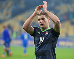 KIEV, UKRAINE - Easter Monday, March 28, 2016: Wales' Sam Vokes applauds the travelling supporters after the 1-0 defeat to Ukraine during the International Friendly match at the NSK Olimpiyskyi Stadium. (Pic by David Rawcliffe/Propaganda)