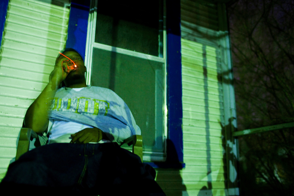 Jabari Wilson smokes a cigarette late at night on the porch he shares with his mother Ellen in the Baptist Town neighborhood of Greenwood, Mississippi on February 19, 2011.