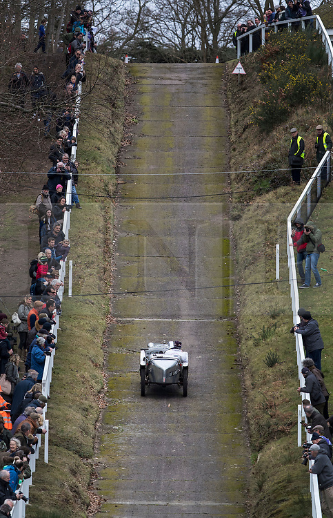 © Licensed to London News Pictures. 28/01/2018. Weybridge, UK. Spectators watch as Olly Sanders tackles the steep gradients in his 1929 Austin 7 Ulster on the hill test at Brooklands Museum during The Vintage Sports-Car Club's New Year driving tests.  Photo credit: Peter Macdiarmid/LNP