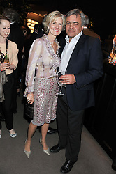 LINDKA CIERACH and BALDASSARE LA RIZZA at the launch party for Spectator Life hosted by Andrew Neil at Asprey, 167 New Bond Street, London on 28th March 2012.