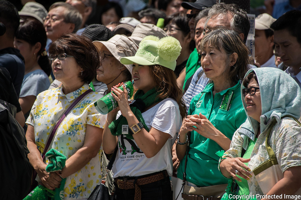 """Supporters listen the speech of Yuriko Koike, a Liberal Democratic Party lawmaker and former defense minister during her speech campaign for the July 31 Tokyo gubernatorial election in front of Meguro Station in Tokyo, Japan on Friday, July 29, 2016. One of Yuriko's slogan for Tokyo is """"Women, men, children, senior, people with disabilities can have a lively life in the city of Tokyo and to be active"""". 29/07/2016-Tokyo, JAPAN"""