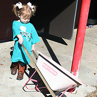 Francie Kate Foote, 2, helps with the garden at ECEC Saturday for the 10 for Tupelo clean up