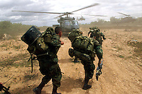 Colombian soldiers head off to combat from Alpujarra, about 150 miles southwest of Bogota, in response to the attack of at least three towns over the night by the Revolutionary Armed Forces of Colombia, FARC, leaving many of the towns in shambles. (Photo/Scott Dalton)