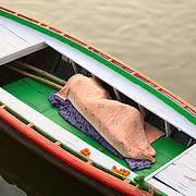 men sleeing inside one of the rowboats at the Ganges, Varanasi