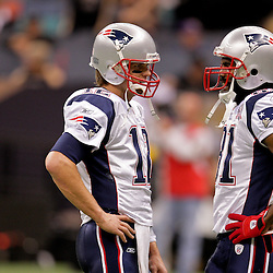 2009 November 30:  New England Patriots quarterback Tom Brady (12) talks to wide receiver Randy Moss (81) prior to kickoff of a 38-17 win by the New Orleans Saints over the New England Patriots at the Louisiana Superdome in New Orleans, Louisiana.